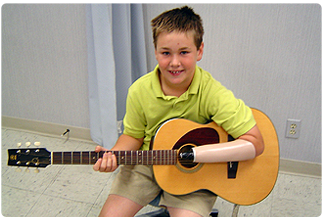 pediatric-prosthetics-boy-guitar