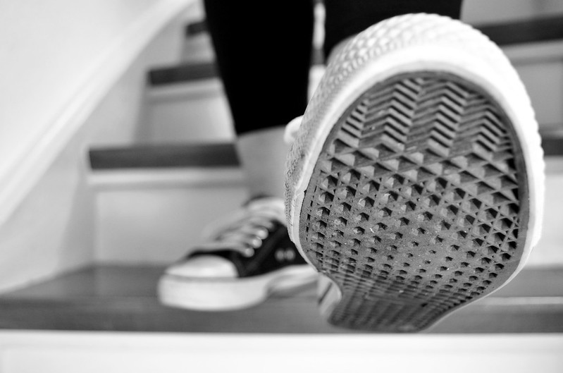walking down stairs in converse black and white