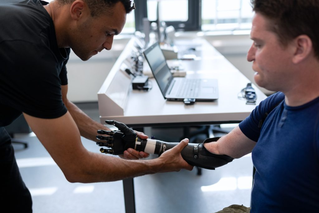 man being fitted with a prosthetic arm